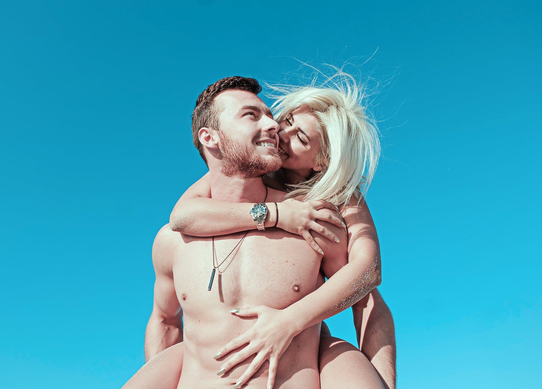smiling woman piggyback riding smiling man